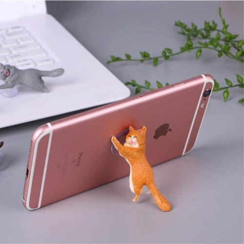 Cute Cat Phone Holder lying on a Flat Surface